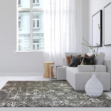Ajoutez un tapis uni ou à motifs dans chacune de vos pièces